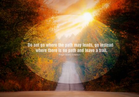 famous writer: Quote of the famous american writer Ralph Waldo Emerson at the landscape with road in sunset fields