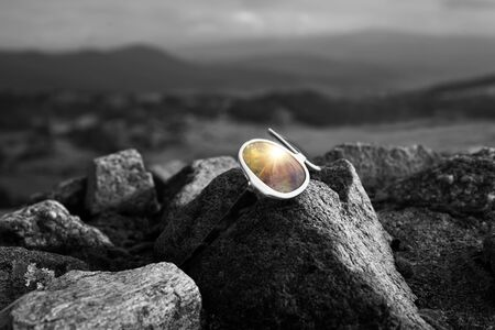 brigh: brigh future is coming conceptual image with sunglasses and black and white background