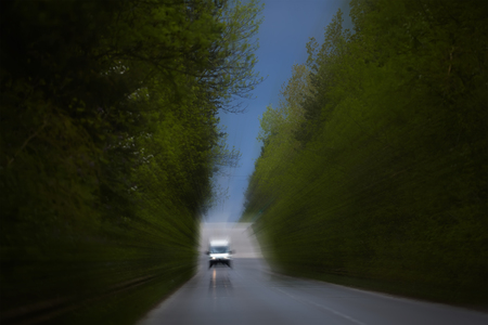 buss: abstract blurred road background with small delivery buss Stock Photo