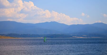 Windsurfer on bulgarian mountain lake