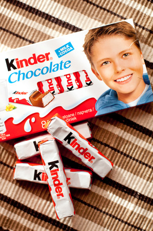 DORKOVO, BULGARIA - MARCH 20, 2017:Kinder chocolate bars on  wooden background.Kinder bars are produced by Ferrero founded in 1946. Editorial