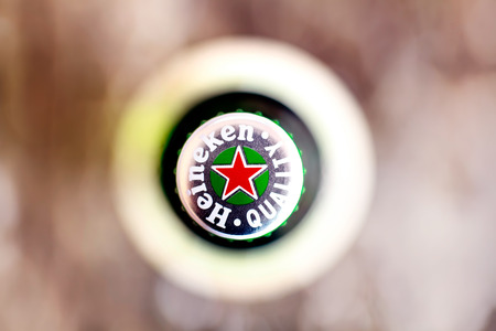 DORKOVO, BULGARIA - MARCH 13, 2017: Macro shot of Heineken bouttle flat lay view from above..Heineken Lager Beer is the flagship product of Heineken International which owns over 125 breweries in more than 70 countries