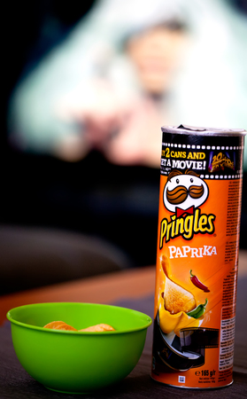 stackable: SOFIA, BULGARIA - OCTOBER 12, 2017: A package of Pringles the Original potato crisps on an movie at home background