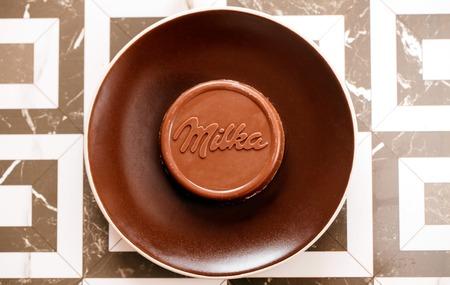 DORKOVO, BULGARIA - DECEMBER 12, 2017: close-up bar Milka old wooden background, alpine milk chocolate. Illustrative editorial