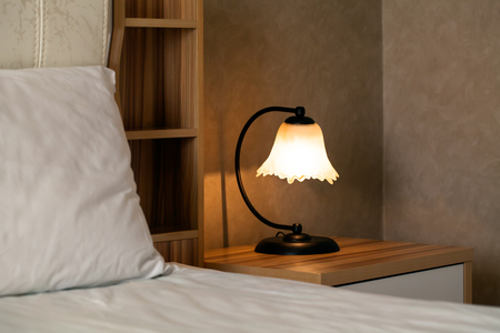 luxury modern details from lapm in hotel bedroom. Stock Photo