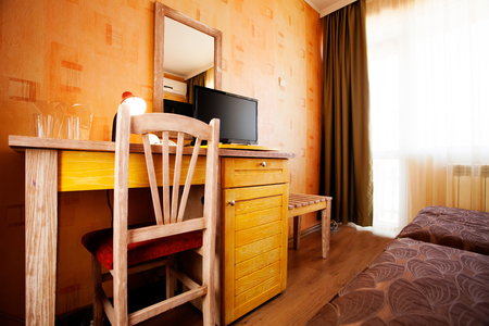 Wooden hotel room tv on the desk Stock Photo