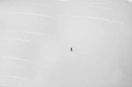 skier on a slope in the mountains, black and white