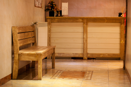 Indoor wooden bench in hotel spa center