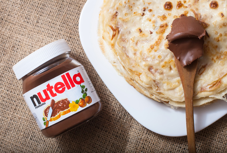 DORKOVO, BULGARIA - DECEMBER 12, 2017: Pancakes with nutella cream.Nutella introduced to the market in 1964 by Italian company Ferrero, Nutella is widely popular brand name of a sweetened hazelnut cocoa spread