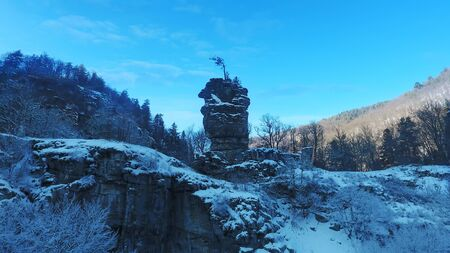 aerial photo of winter forest and strange rock formation in Bulgaria Imagens