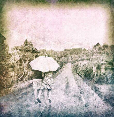 couple walking in rainy forest, abstract vintage background, some noise added for stronger vintage effect Archivio Fotografico