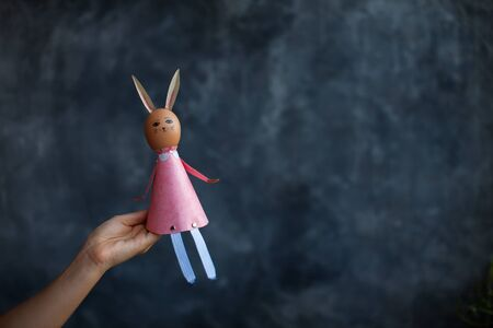 Easter bunny, rabbits sitting on the hand , background, color Easter pink egg,