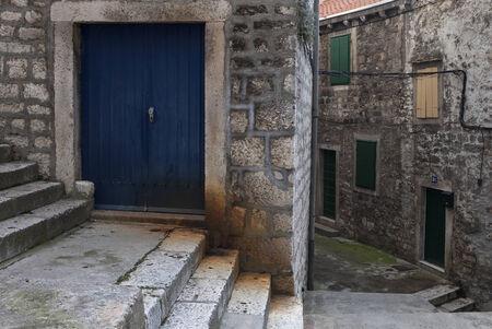 blue door in streets of old mediterranean cityn