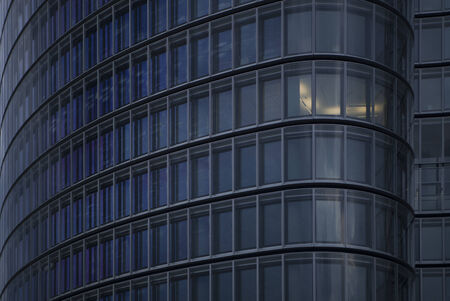 detail of skyscraper with one illuminated office