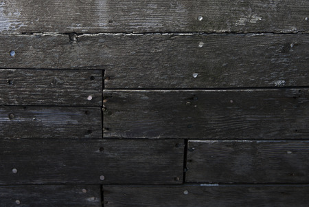 detail of wooden boat hull eroded by salt and sun