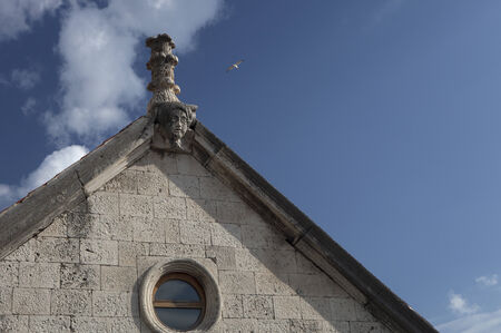 church facade with architectural sculpture Stock Photo
