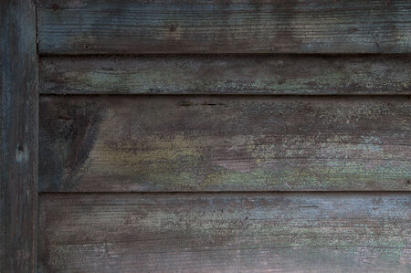 detail of dilapidated wooden door with decaying paint