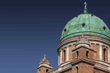 cupola with corroded copper plates and two turrets on church at Mirogoj