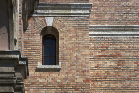 window on bricked wall with stone made architectural details - orthogonal composition Stock Photo