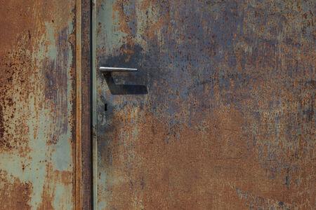 corodded grungy metal door with handle