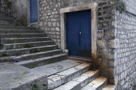 blue doors on stone stairway