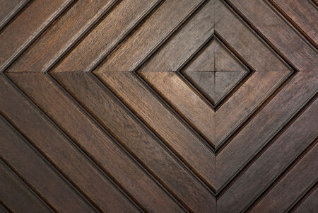 detail of door with concentric squares carved in wooden boards Stock Photo