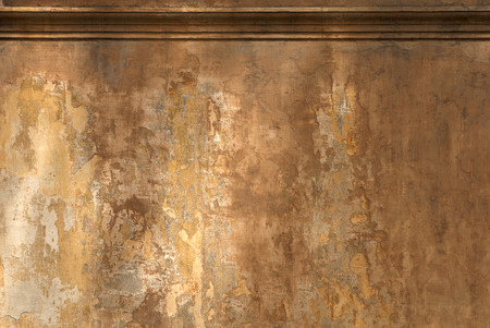 empty wall painted with many layers of fading warm tones