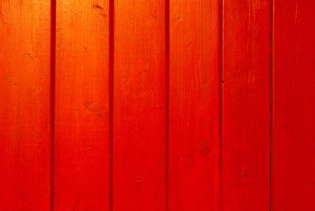 empty red background with blank wooden planks reflecting sunset light