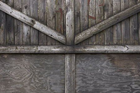 old gate made of rough wooden boards Stock Photo