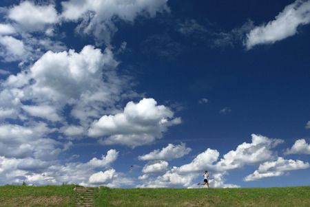beautiful blue sky with small unidentifiable running healthy human figure