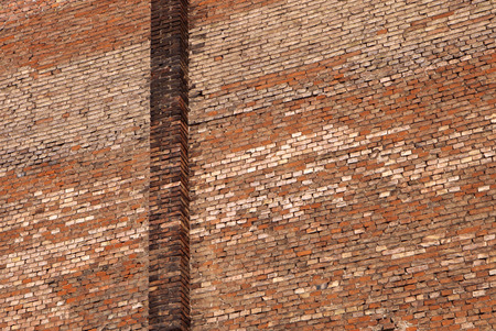weathered texture of red brick wall for background