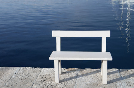 small white empty bench by the sea Stock Photo