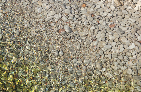 texture of pebbles in shallow sea water