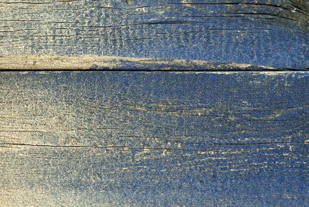 texture of rough wooden board with fading blue paint Stock Photo