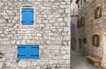typical mediterranean city with narrow streets and stone houses with colorful windows
