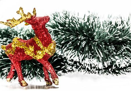 Christmas rain deer with green snowy background Stock Photo - 23051273