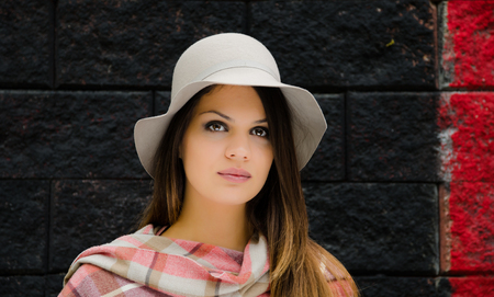 Beautiful girl with hat and scarf  photo