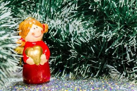 Christmas angel with golden heart  photo