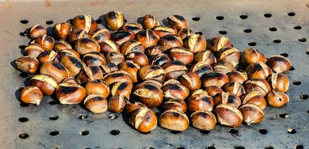 Baked chestnuts on iron pot  Stock Photo