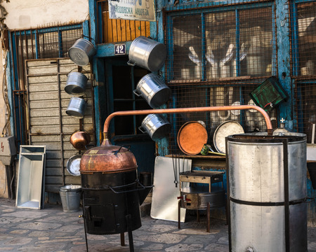 marc: Iron pots and all kind of iron objects for the house in front of a hand made store in alley in the Old Bazaar in Skopje