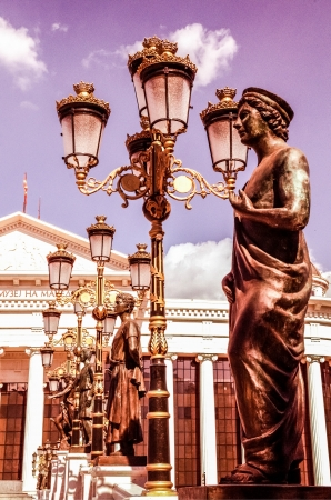 The statues on one of the bridges in the center of the city of Skopje