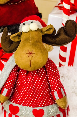 Raindeer dool in red and gray clothes