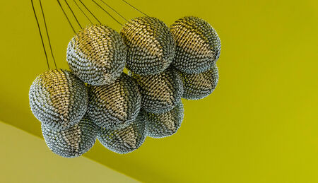 transitional:  Silver chandelier hanging from the yellow-green ceiling