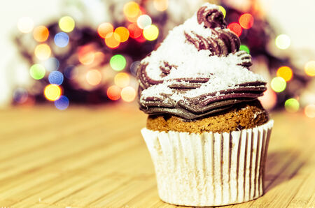 Chocolate cupcake with cocos crumps on the top of the chocolate cream  Stock Photo