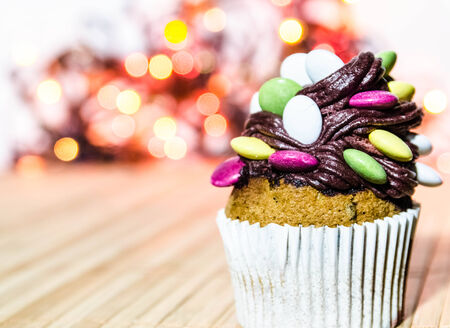 Cupcake with candies on top of the chocolate cream  Stock Photo