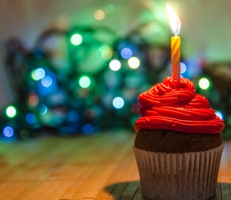 Red cream cupcake with candle Stock Photo