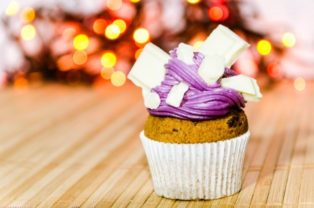 Cupcake with violet cream and white chocolate
