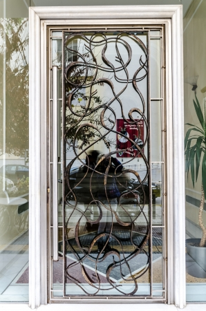 Artistic metal door on a entrance of a moredn-style building  Stock Photo