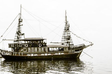 Black and white image of a ship in the waters of the Aegean sea in the city of Thessaloniki