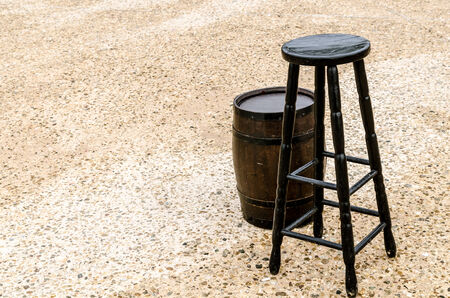 Chair and a barrel in the concrete floor  Stock Photo - 25080786